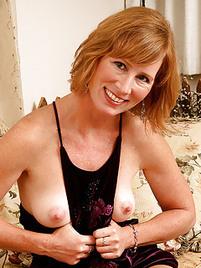 Nude thumbs Mature redhead